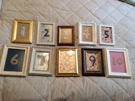 10 unique rustic table numbers, photo frames with hand-made fabric inserts. Barn, vintage wedding