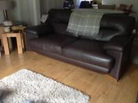 Pair of brown high quality leather sofas with oak coloured wooden feet