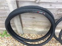 Bicycle tyres, 2 pairs, one never used