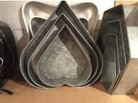 Three piece heart shaped tins