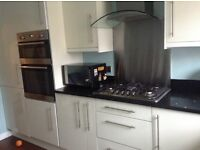 Kitchen white with black sparkle quartz worktop complete with fridge, freezer, oven and hob