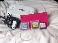 Nintendo DSI with charger, 3 games, case and stylus