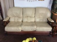 Cream leather and wood sofa and chair in good condition £65 buyer to collect