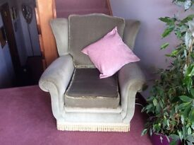 Traditional style armchair in green fabric.