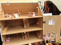Beautiful wooden dolls house with dolls and furniture