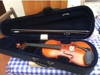 Brand new violin and case.