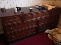Chest of drawers and matching bedside unit.