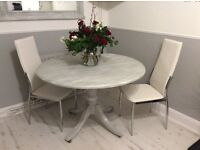 Upcycled table ,waxed ,with 2 brand new chairs still in the box ,height 76cm ,width 110 cm