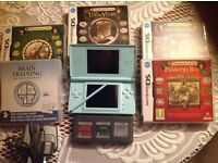 Mint condition Nintendo DS Lite with charger and 4 Prof Layton games plus Brain Training