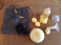 Medela swing electric breast pump with bottles and breast pads