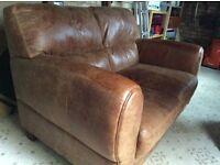 Tan coloured leather 2 seat sofa