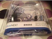 Bluetooth head phones, with microphone. Operation range, 10meters.