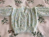 HAND KNITTED BABY CARDIGAN. WHITE/SPECKLED. NEW.