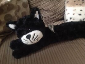 Black and white cat draught excluder with tag