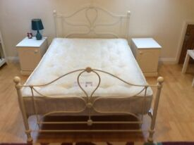 Cream metal framed double bed with mattress. Excellent condition, used occasionally..