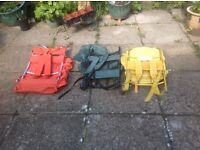 A selection of used rucksacks in different colours.