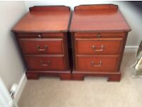 A pair of John Coyle bedside cabinets
