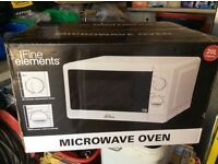 Fine Elements Microwave oven still in box. 700w x 20Ltr