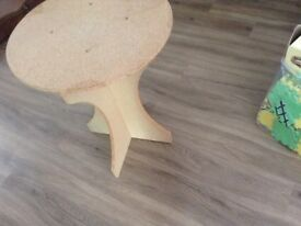 Small mdf table could be painted..portable as can be dismantled. Perfect with tablecloth on top