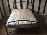Metal framed double bed with mattress