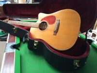 Jasmine electric acoustic guitar complete with hard case,nice condition ,good sound.