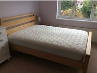 Bensons for beds Solid ash double bed frame, price includes mattress.