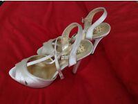 Ivory satin high heel shoes