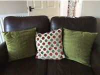 7 Cushions in green/orange/cream