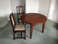 46inch extending dining table in dark wood along with 4 chairs