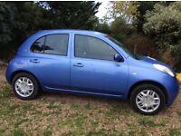 Blue Nissan micra