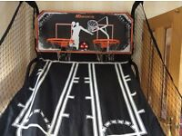 Indoor basketball game with electric scoreboard