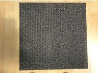 Grey carpet tiles used heavy duty