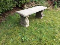 A lovely garden concrete bench