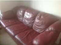Two seat and three seat red leather sofas,