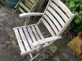 Three teak garden chairs