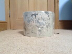 New, still in wrapper, muted grey and blue patterned fabric light shade.