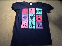 Girls navy T-shirt with cute logos on in pink size 9-10