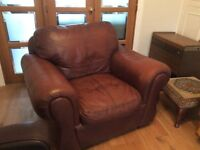 Large tan leather armchair