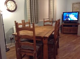 Wooden dining table with six chairs. Size 5 ft x 3 ft. Good condition. £70