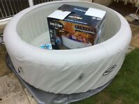 Lay-Z-Spa Paris HOT TUB + Clearwater chemical Starter Kit worth £428