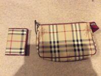 Genuine and original Burberry handbag and matching purse.