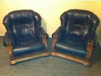 2 black leather sofa chairs with oak surrounds