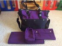 Icandy black and purple baby changing bag.