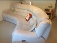 BIege 4 person sofa with electric recliners at each end.