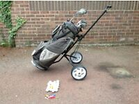 Full set of golf clubs with Donney trolley with the added bonus of balls and tees