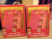 2 Dora The Explorer Single Duvet Covers (new) & 2 Dora Fleece Blankets - Twins
