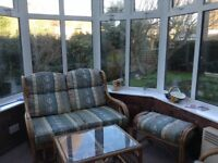 2 seater sofa 2 chairs table and matching footstool. Blue and cream pattern. Reasonable condition
