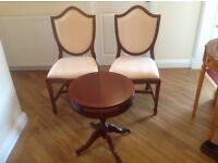 Two dark brown chairs and small matching coffee table. Never used.
