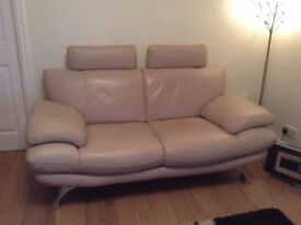 Two matching leather sofas, excellent condition, 2 seater with steel legs, contemporary.