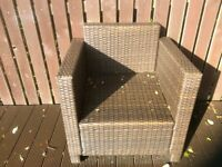 Brown rattan tub chairs and rattan coffee table